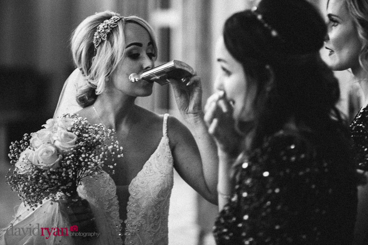bride drinking from a hip flask