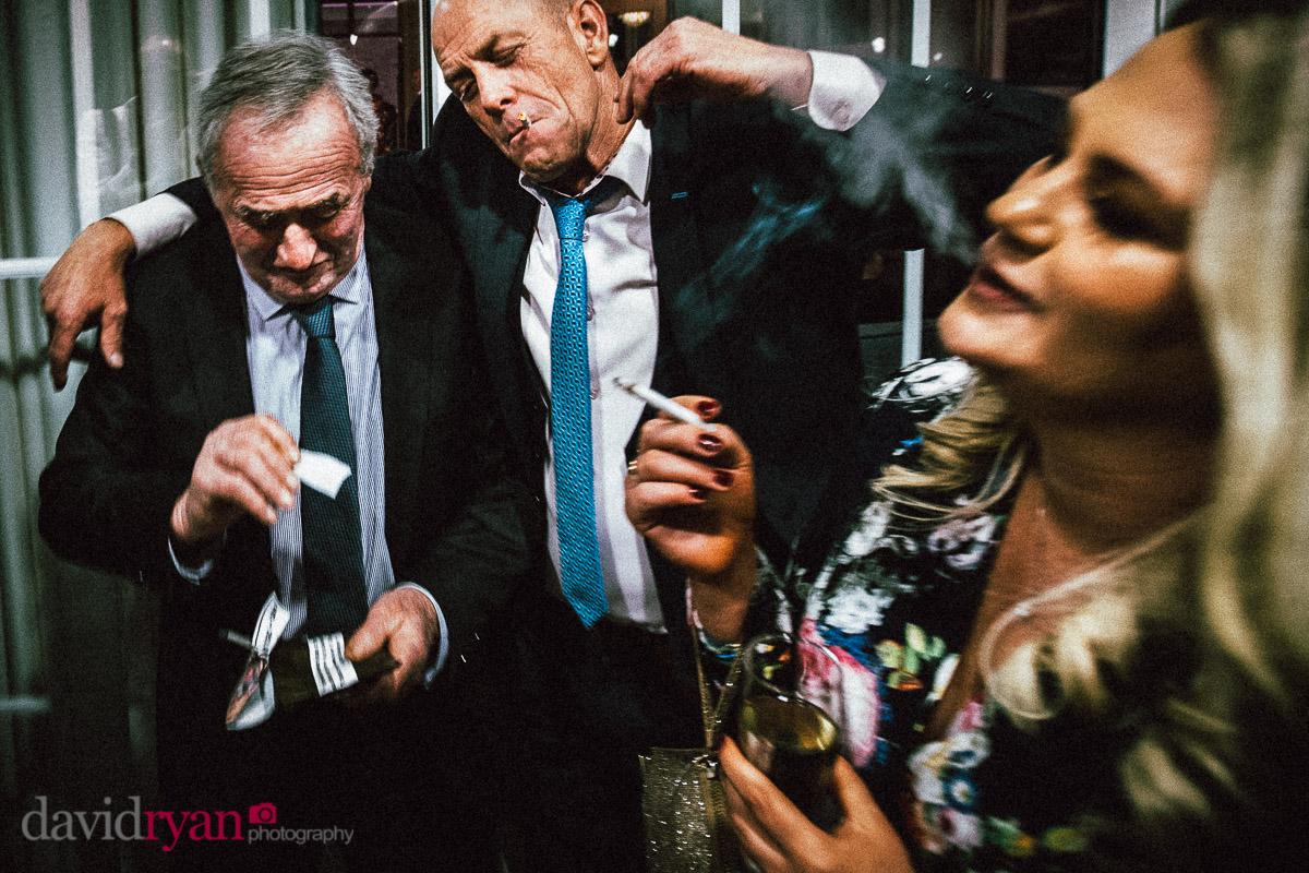 people smoking and drinking