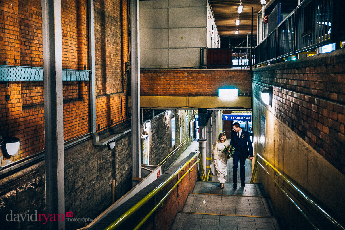 married couple walking through a rail statiion